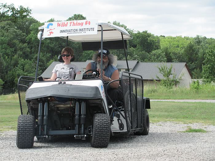 Wandus gives a young woman a ride on the White Hybrid Kart.