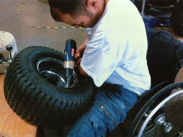 Chris makes modifications to one of the wheels.