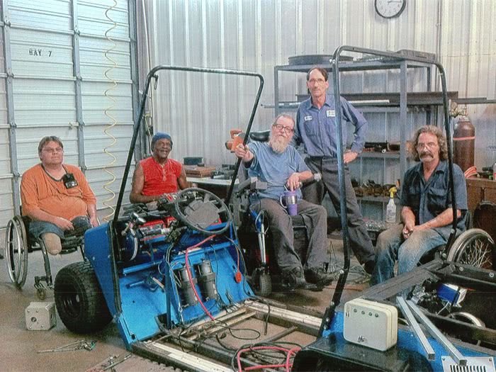 Tony, Tommie, Jim, Harrold, and Ed pause for a photo during work on the Blue Hybrid Kart.